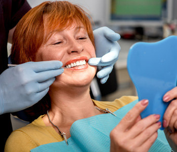 Senior woman in the dental