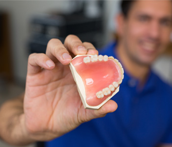 Dental technician presenting dental prosthesis